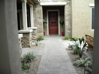 Arizona Landscape Travertine Paver Courtyard with path lights, plants, & drip irrigation system.