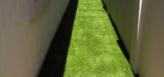 Artificial turf on this sideyard creates a great dog run!