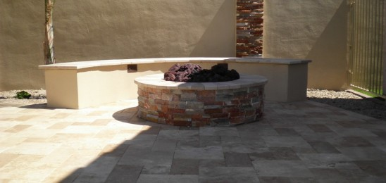 This patio firepit not only provides family but serves as a beautiful centerpiece in this Arizona landscape design.