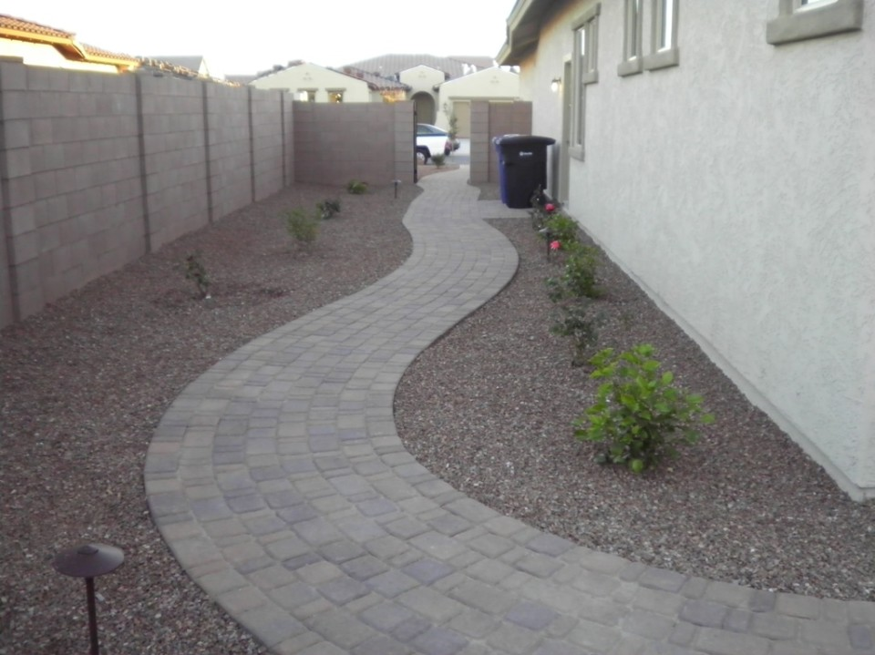 A walkway featuring pavers can create visual interest.
